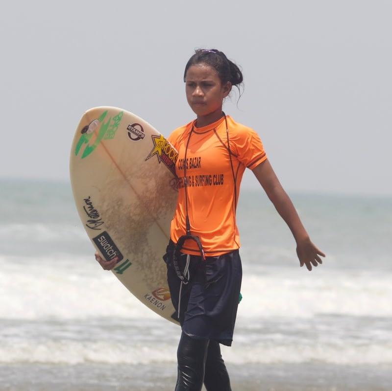 Shobe walking with surf board